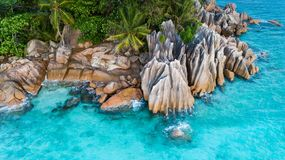 Tropical island with sea and palm taken from drone. Seychelles aerial photo. St Pierre Island stock photo