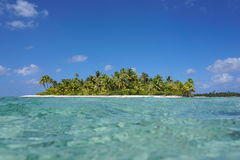 Tropical island seen from the sea surface Royalty Free Stock Photo