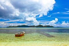 Tropical island at Seychelles and boats Royalty Free Stock Images