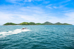 Tropical island and speed boat going to island Royalty Free Stock Photo