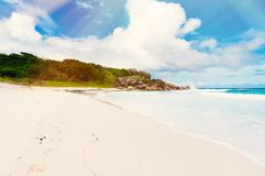 Tropical island on the sunny day. Photo of a tropical island on the sunny day stock images