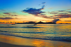 Tropical island at sunset Stock Images