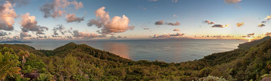 Tropical island sunset from high mountain. Beautiful tropical vacation in the warm sunny Seychelle island oceans and palm trees Stock Image
