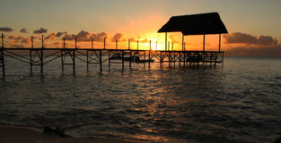 Tropical Island Sunset and Pier Royalty Free Stock Images