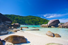 Tropical island surrounded by cliffs and jungle Stock Photo