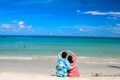 Couple looking at the sea-Sweet trip for two royalty free stock photo
