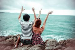 Couple looking at the sea-Sweet trip for two royalty free stock image
