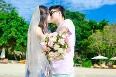 Wedding bouquet in front of young couple background royalty free stock photography