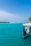 Tropical island with traditional boat Dhoni, Maldives. Tropical island with white sand beach, palm trees and traditional boat Dhoni, Maldives Stock Images