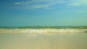 Tropical island. Transparent water at the coast of the island in Vietnam. Sunny day on the beach of the desert island. On this video you can see blue waves on stock footage