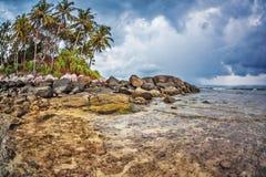 Tropical island under gloomy sky Royalty Free Stock Photo
