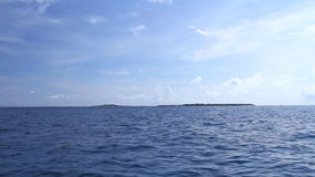 Tropical island, view from boat. Tropical island, view from riding boat stock video footage