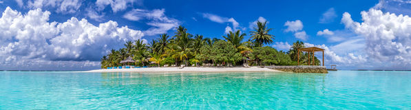 Tropical island with white sand and palm trees at Maldi Stock Photos