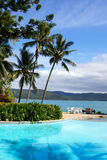 Tropical Island in the Whitsundays. Pool and sea portrait style image with coconut palms setting in Whitsundays, Australia Royalty Free Stock Photos
