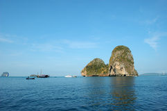 Tropical islands. Limestone Scarps, rising out of the sea at Krabi, Thailand Stock Image