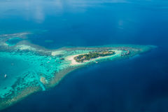 Tropical islands and atolls in Maldives from aerial view. Showing beaufitul untouched nature Stock Image