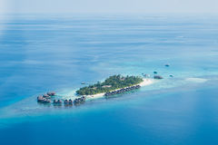 Tropical islands and atolls in Maldives from aerial view. Showing beaufitul untouched nature Royalty Free Stock Image