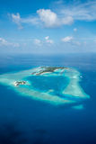 Tropical islands and atolls in Maldives from aerial view. Showing beaufitul untouched nature Royalty Free Stock Photos