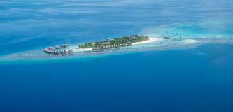 Tropical islands and atolls in Maldives from aerial view. Showing beautiful untouched nature Royalty Free Stock Image