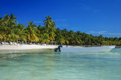 Tropical Islands with palm trees and speed boat on the coastline Stock Photography