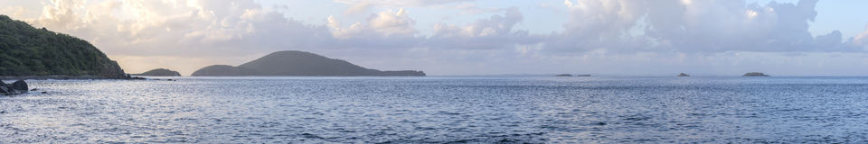 Tropical islands panoramic. Beautiful wide panoramic of morning sky over the Caribbean islands on the south side of Isla Culebra Royalty Free Stock Image