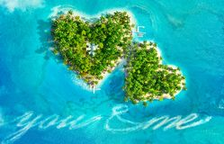 Tropical islands in the shape of heart and boat writing text `you and me`. Aerial view. 3D illustration