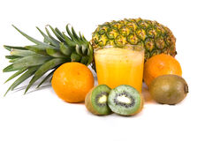 Tropical juice. Photo of a fruit juice with fruits on background Stock Image