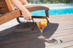 Tropical juice by swimming pool royalty free stock photography