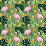 Tropical jungle seamless pattern with flamingo bird, palm leaves and flowers. Flat design, vector illustration. Tropical jungle seamless pattern with flamingo Stock Photos