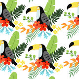 Tropical jungle seamless pattern with toucan bird, heliconia and hibiscus flowers and palm leaves, flat design. Vector Stock Photo