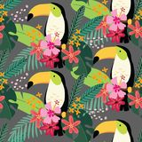 Tropical jungle seamless pattern with toucan bird, hibiscus flowers and palm leaves. Flat design, vector illustration. Tropical jungle seamless pattern with Stock Images
