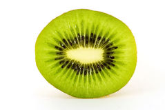 Tropical kiwi. A studio shot of a tropical kiwi fruit, on a white background. The image is taken with a high quality macro lens Stock Images