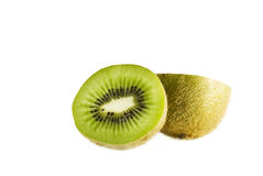 Tropical kiwi. A studio shot of a tropical kiwi fruit, on a white background. The image is taken with a high quality macro lens Royalty Free Stock Photos