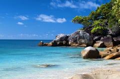 Tropical lagoon. With sand beach and blue sky Stock Photos