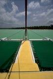 Tropical lagoon catamaran navigable   in  dominicana. Tropical lagoon catamaran navigable  froth cloudy   boat  and coastline in republica dominicana Stock Photo