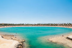 Tropical lagoon in Egypt with turquoise water and blue sky Stock Photos