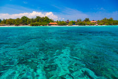 Tropical lagoon. Tropical azure lagoon and island on the horizon stock photos