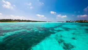 Tropical lagoon from moving boat in Maldives. Vibrant tropical coral lagoon from moving boat in Maldives stock video