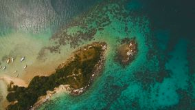 Beautiful tropical beach, aerial view. Tropical island. Tropical lagoon with turquoise water and white sand. Beautiful beach. Tropical bay in El Nido. Aerial stock footage