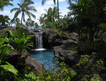 Tropical lagoon and waterfall royalty free stock images