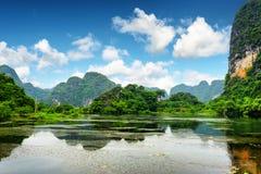 Tropical lake among karst towers at Ninh Binh Province, Vietnam Stock Photos