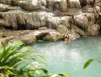 Tropical lake with women Royalty Free Stock Image