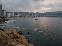 Tropical landscape in Acapulco bay at sunrise. Located in the state of Guerrero, city with beach and tropical climate for vacation, saltwater Sea of the Pacific stock photos