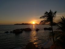Tropical landscape in Acapulco bay at sunset. Travel and tourism in Mexico, pacific sea and ocean view stock photography
