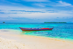 Tropical landscape with islands and lonely boat. Indonesia, Southeast Asia Royalty Free Stock Photography