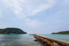 Tropical landscape of Koh Kood. Summer landscape on tropical koh Kood island in Thailand. Landscape with long wooden pier taken on Bang Bao beach Stock Photos