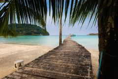 Tropical landscape of Koh Kood. Summer landscape on tropical koh Kood island in Thailand. Landscape with long wooden pier taken on Bang Bao beach Royalty Free Stock Images