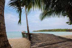 Tropical landscape of Koh Kood. Summer landscape on tropical koh Kood island in Thailand. Landscape with long wooden pier taken on Bang Bao beach Royalty Free Stock Photography