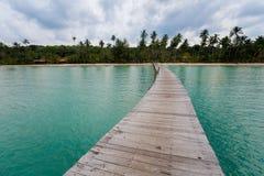 Tropical landscape of Koh Kood. Summer landscape on tropical koh Kood island in Thailand. Landscape with long wooden pier taken on Bang Bao beach Stock Image