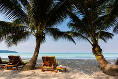 Tropical landscape of Koh Kood. Summer landscape on tropical koh Kood island in Thailand. Panorama of white sand beach with coconut palms taken on Klong Chao Royalty Free Stock Images